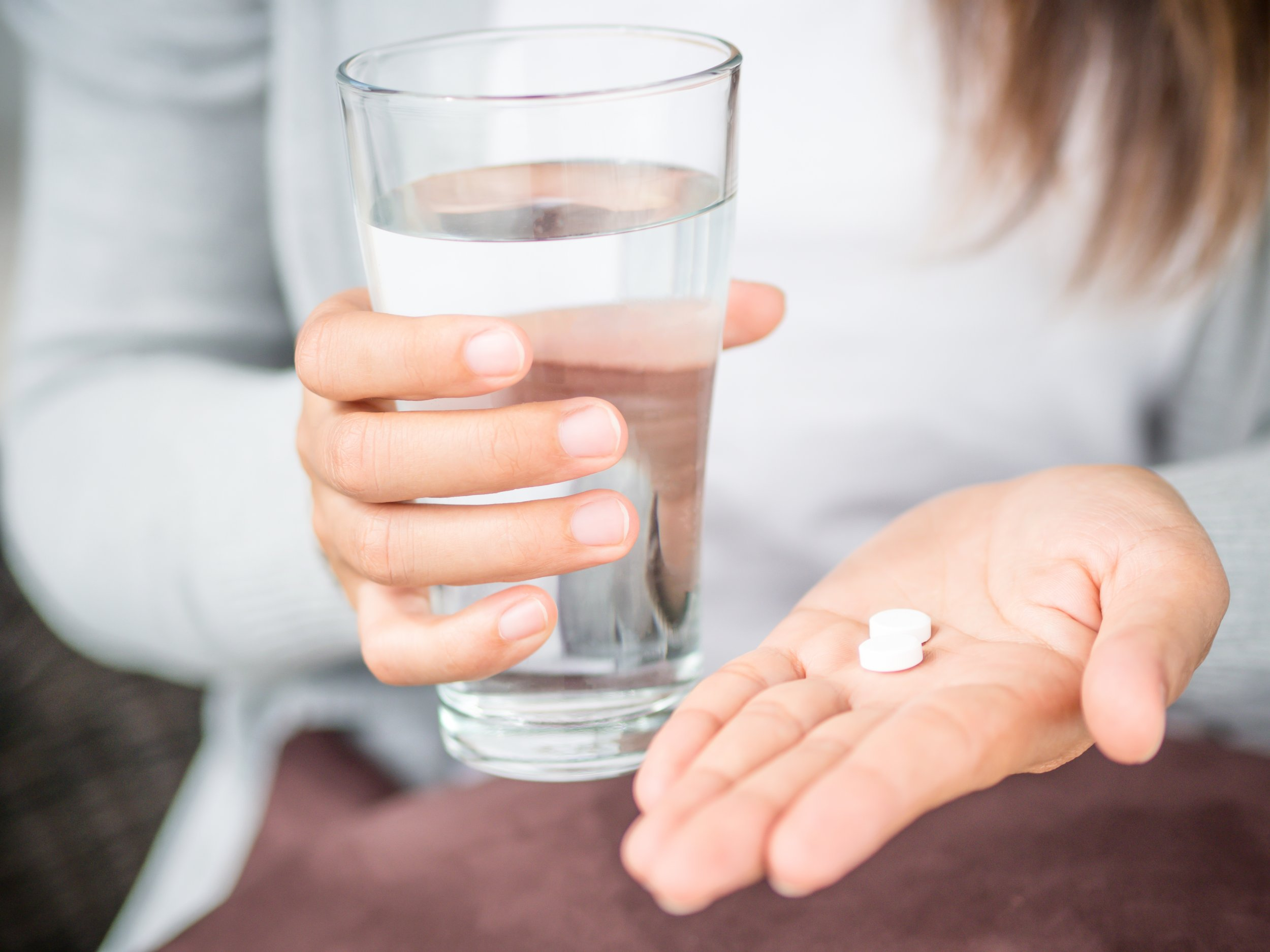 drug woman hand medicine getty stock