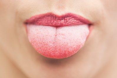 tongue mouth face stock getty