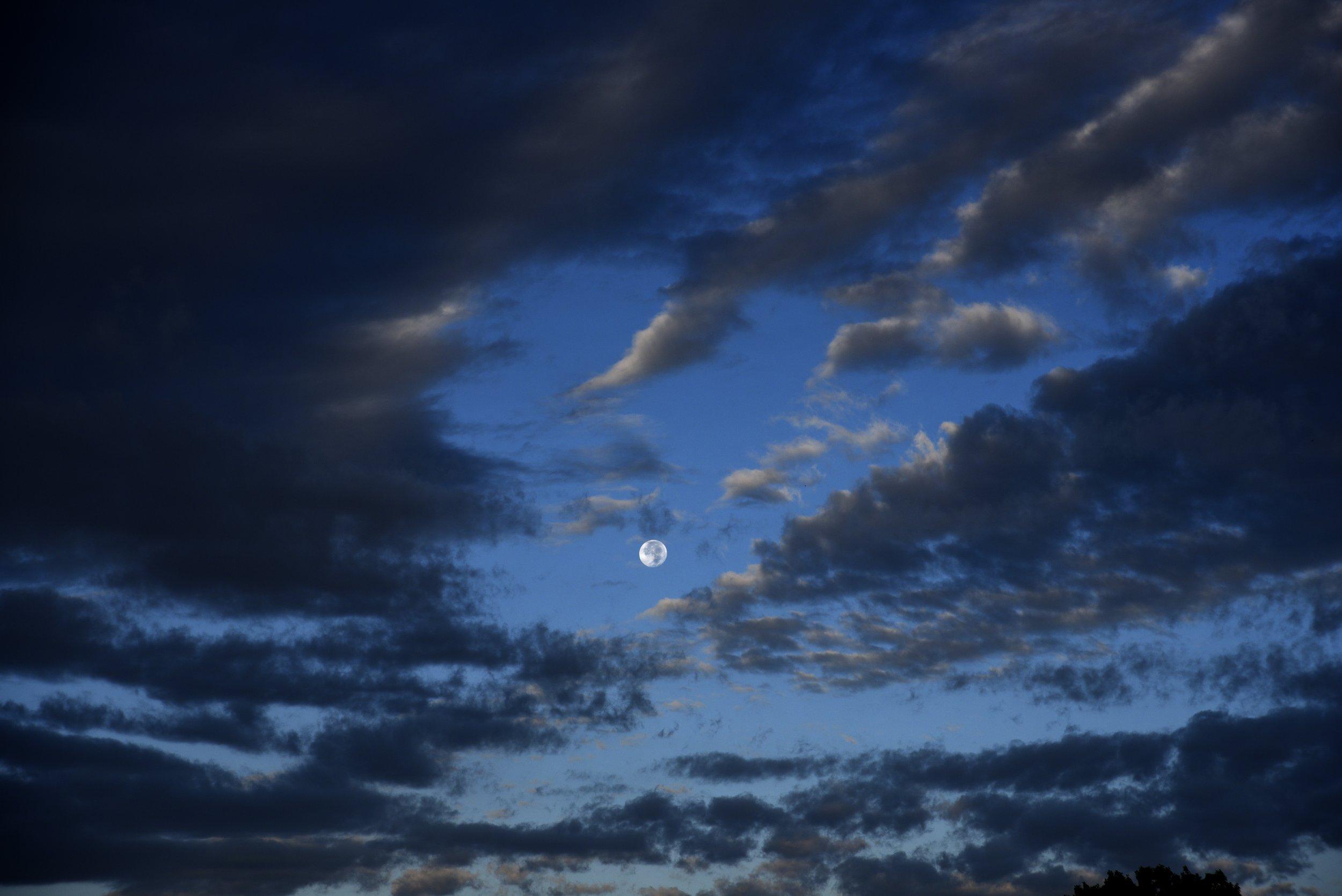 full moon dusk blue sun