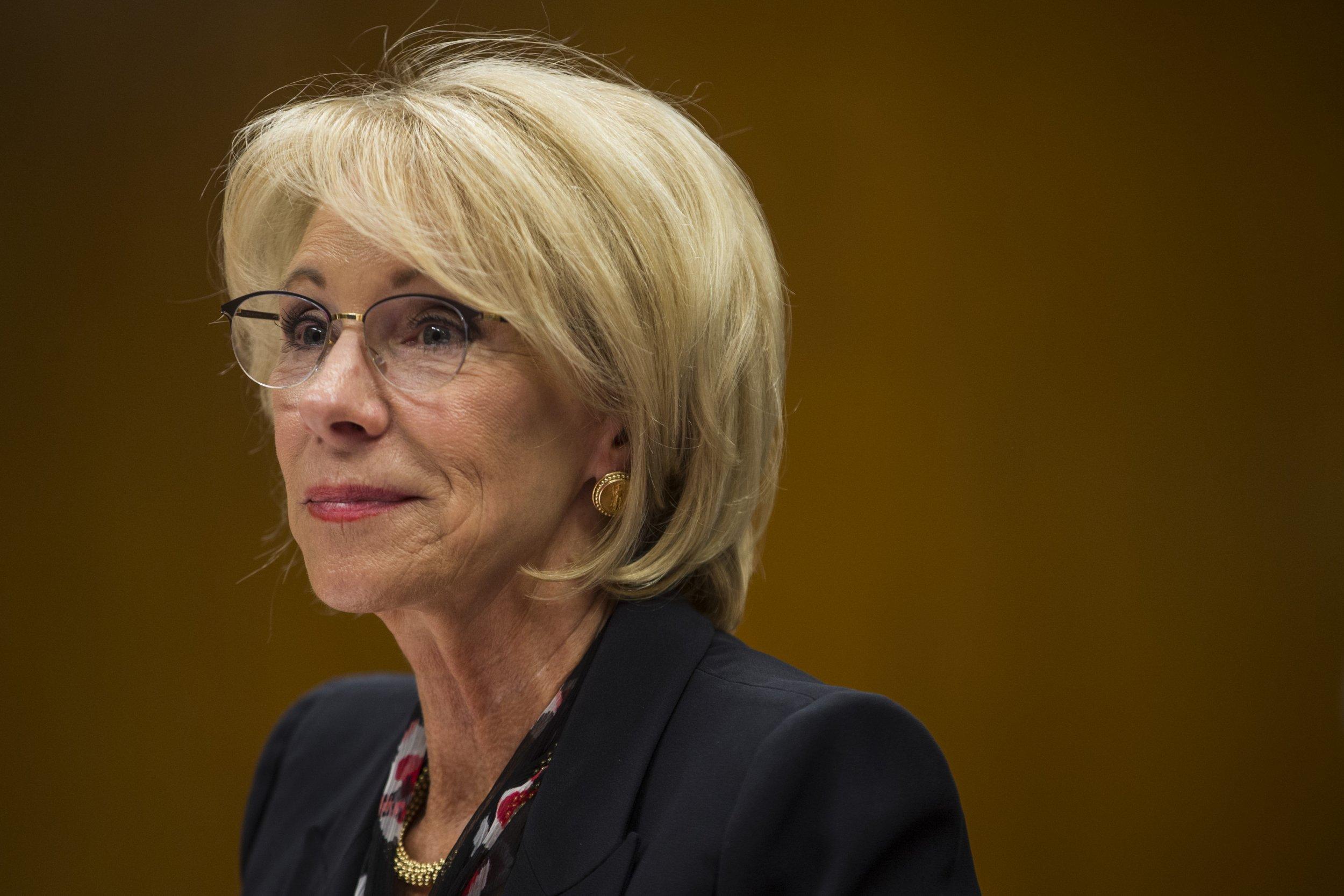 Betsy DeVos teacher strike education AFT