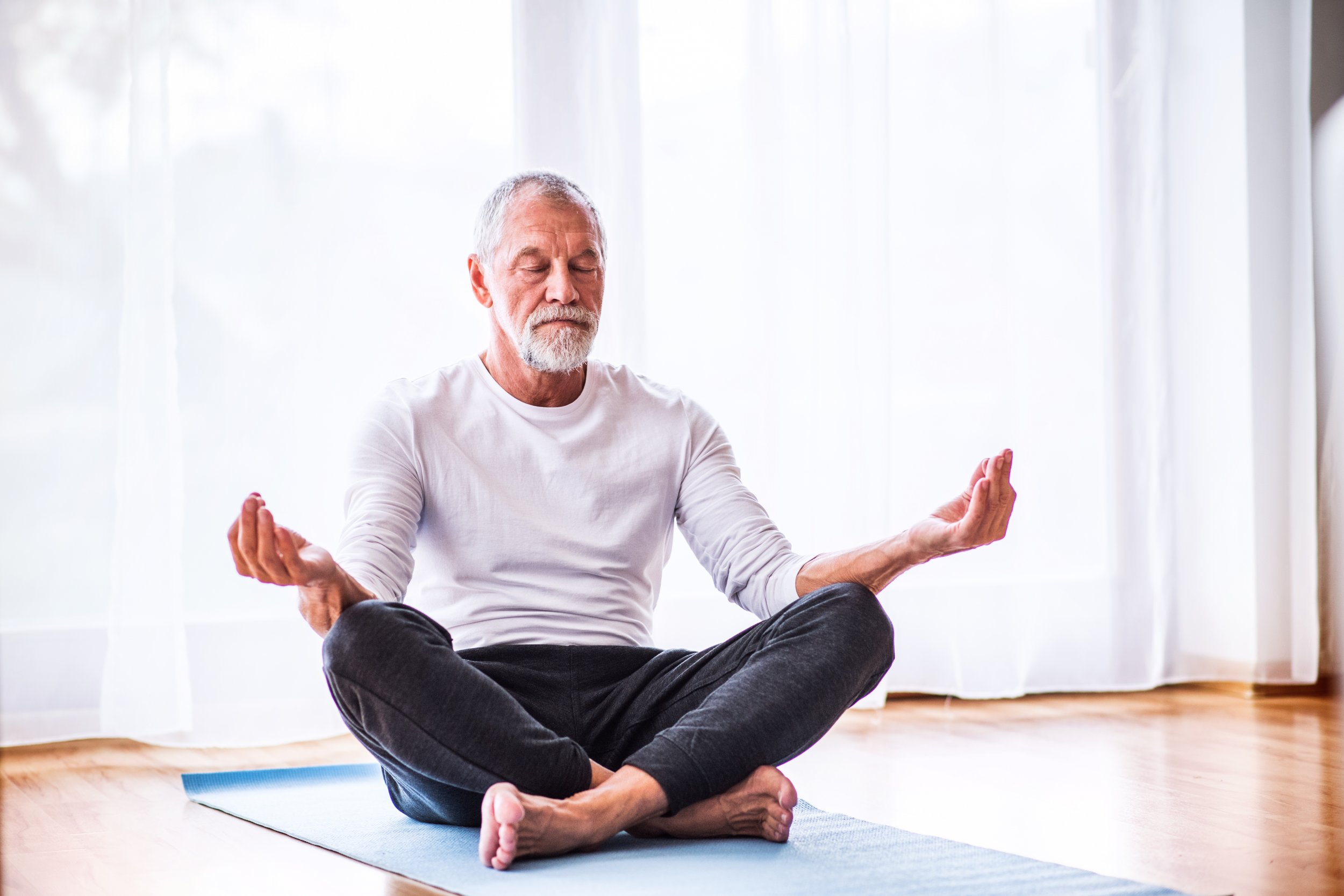 meditation yoga old man stock getty