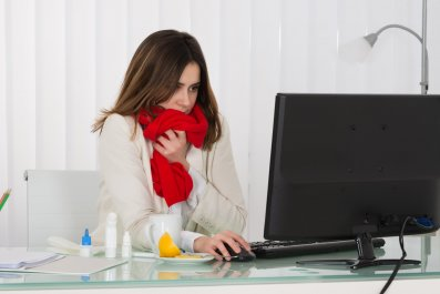 cold woman office stock getty