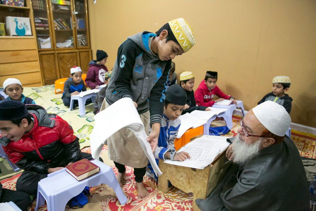 Children participate in a Koran clas