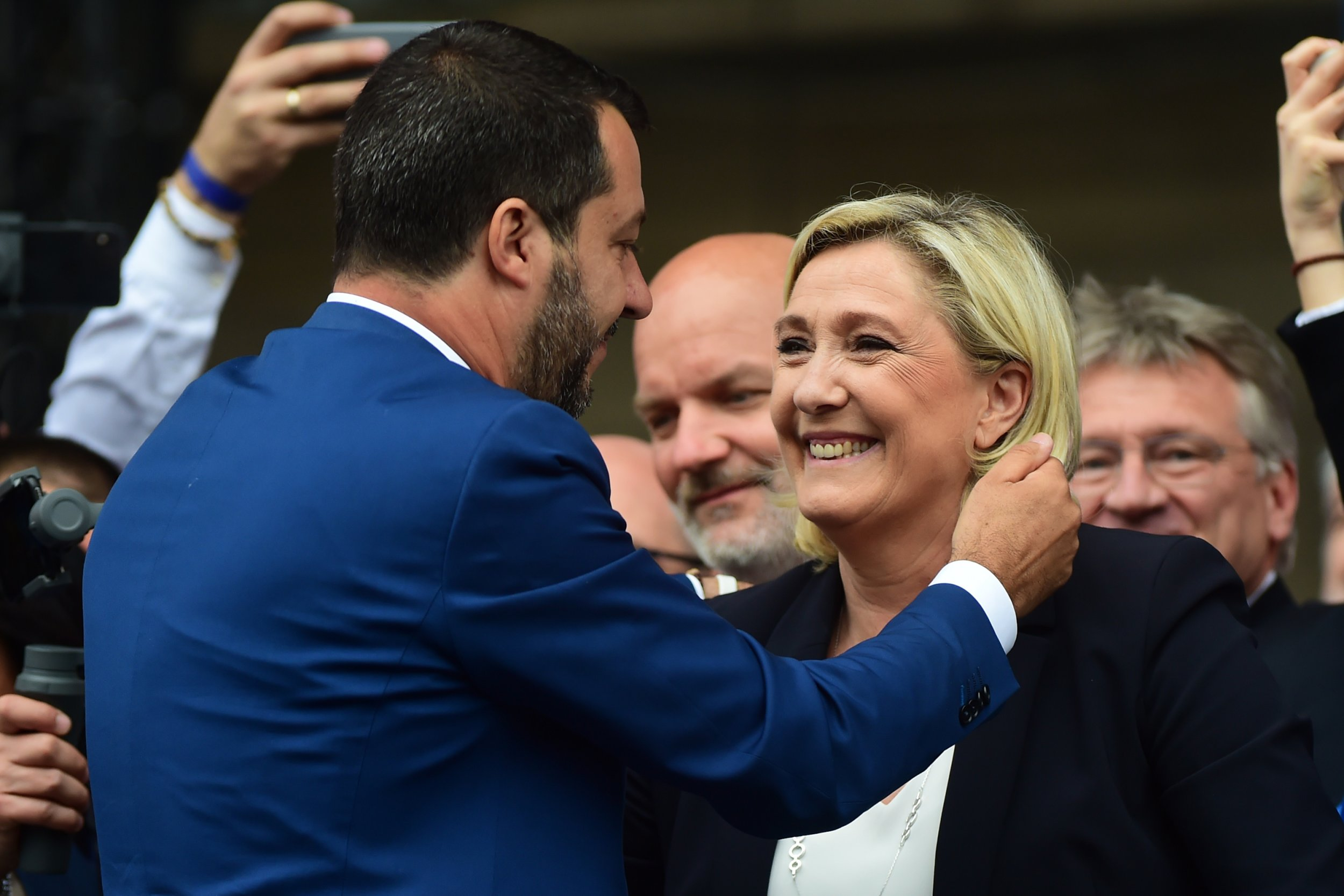 , Matteo Salvini embraces Marine Le Pen during demonstration ahead of the European elections in Piazza Duomo on May 18, 2019 in Milan, Italy </span> <span class=