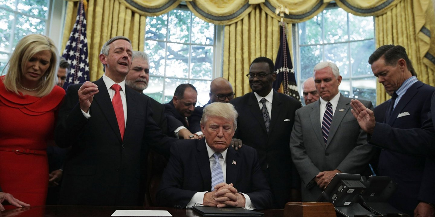 Trump praying with faith leaders in Oval Office