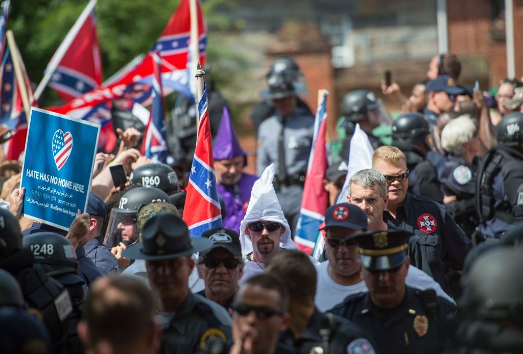 Members of the Ku Klux Klan arrive for a rally
