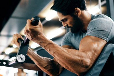 man gym fitness working out stock getty