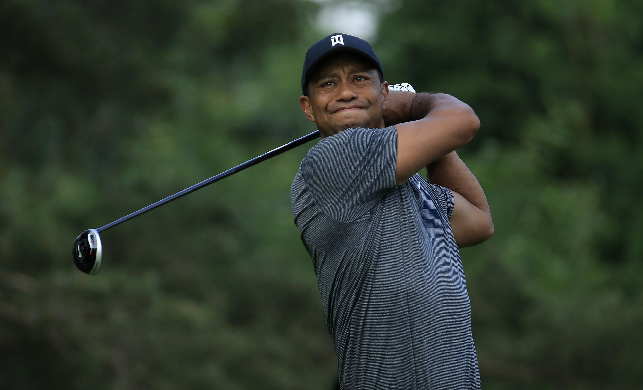what time does tiger woods tee off on thursday  memorial