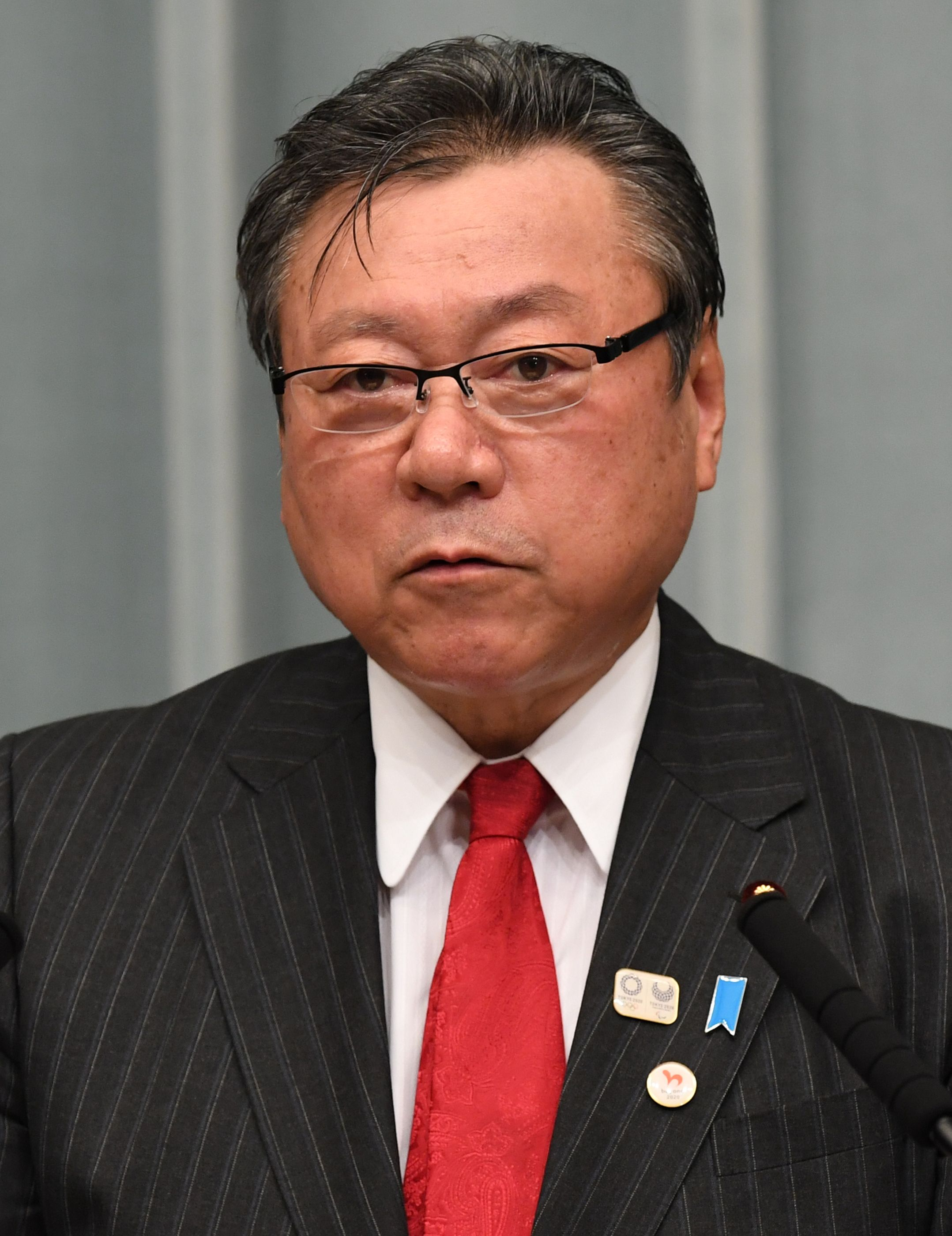 This October 2, 2018 picture shows Yoshitaka Sakurada speaking during his press conference at premier's official residence in Tokyo following Prime Minister Shinzo Abe's cabinet reshuffle.