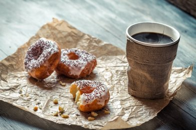 coffee cup donuts breakfast stock getty