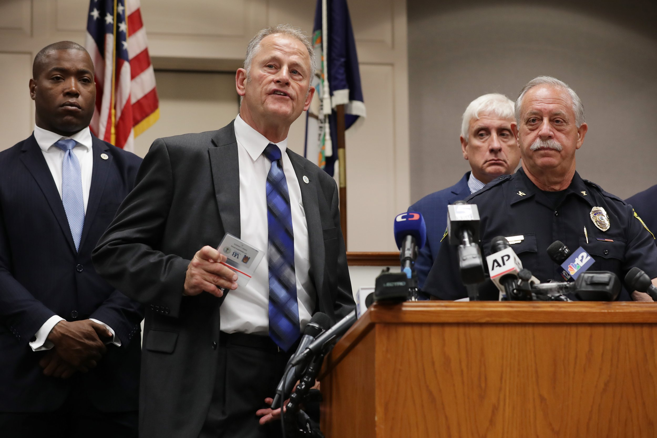 Suspect in US shooting resigned before killing 12