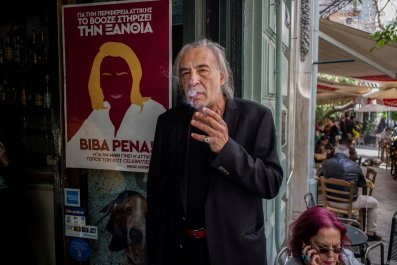 Bar owner Nikos Louvros, who heads Greece's pro-smoking KOTES group, smokes in his bar in Athens on May 7, 2019.