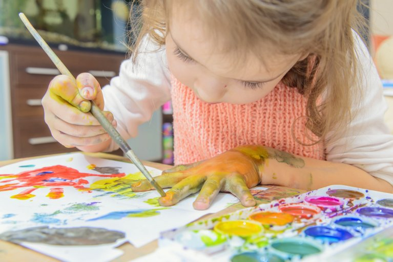 child paint girl stock getty