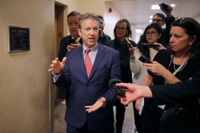 Senator Rand Paul talks to reporters