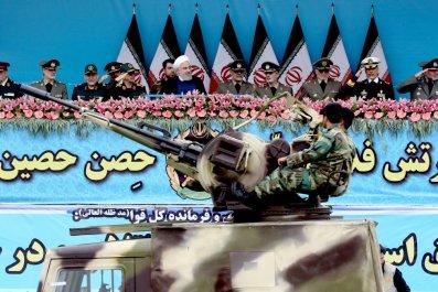 Hassan Rouhani watches Iranian military parade