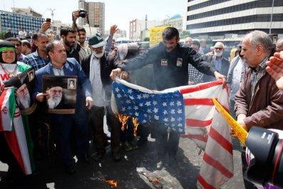 Iranian demonstrators burn U.S. flag