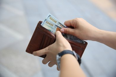 wallet cash money dollar stock getty