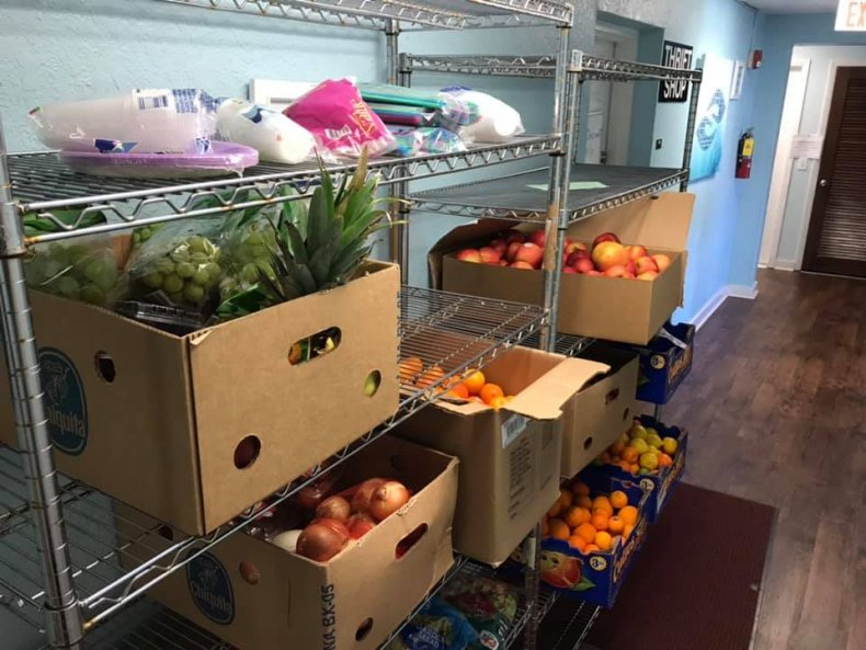 student donates groceries south brevard sharing center