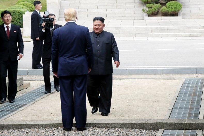 Trump crosses demarcation line to greet Jong-un