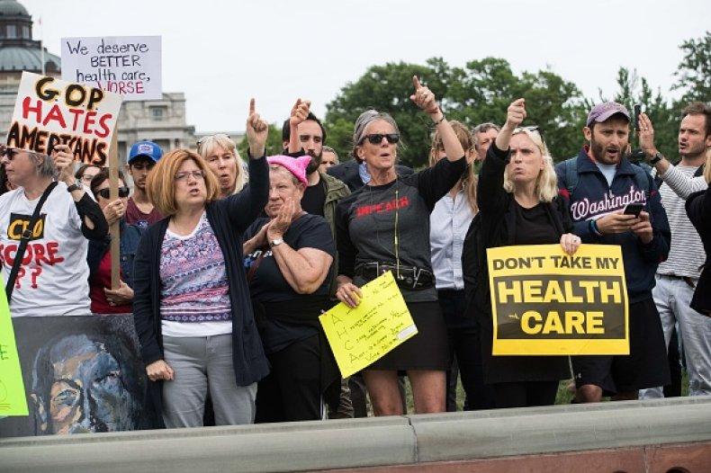 protesters respond trump obamacare attacks