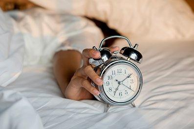 sleep, alarm clock, bed, woman, stock, getty,