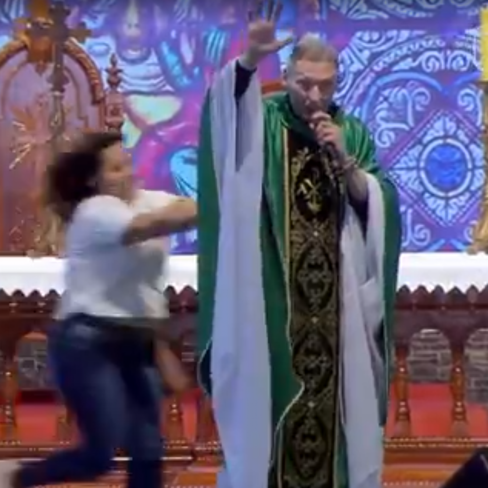 Video: Woman Violently Pushes Priest Off Stage During Mass