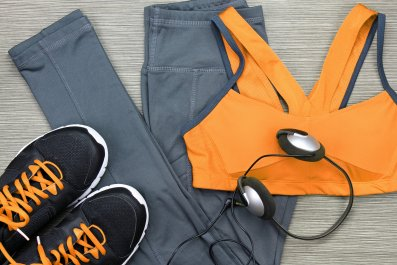 workout clothing, running shoes, headphones, smartphone, getty