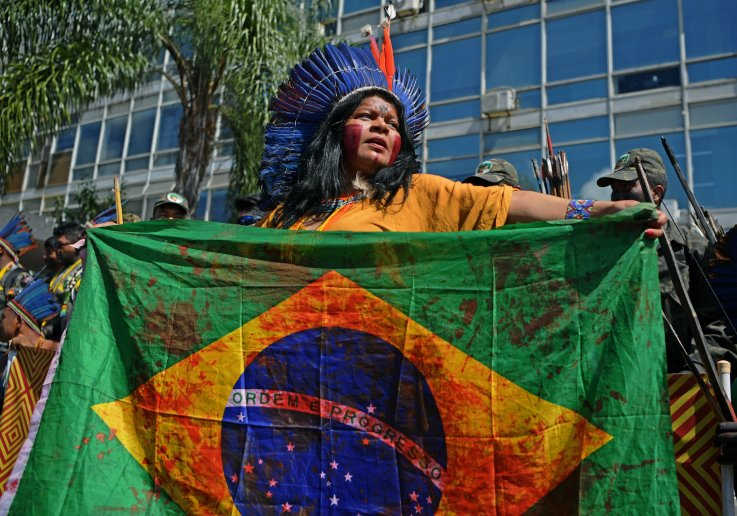 indigenous woman, Brazil, protest, getty, Brasilia