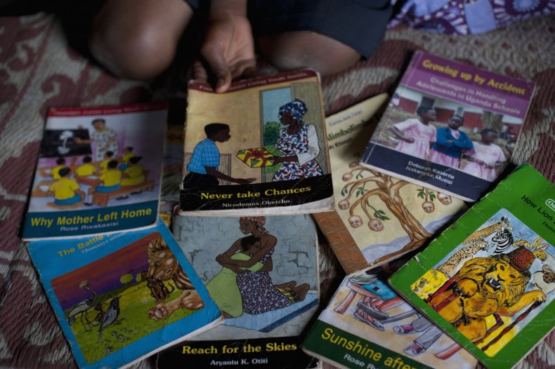 Girls read educational books at an adolescent youth center in Uganda.