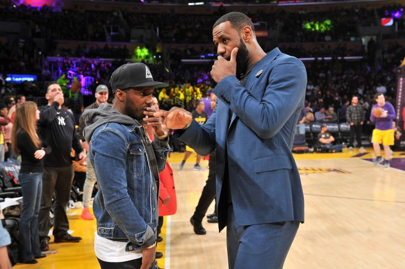 LeBron James talks to his agent Rich Paul during halftime of a basketball game between the Los Angeles Lakers and the Cleveland Cavaliers at Staples Center on January 13, 2019 in Los Angeles, California.
