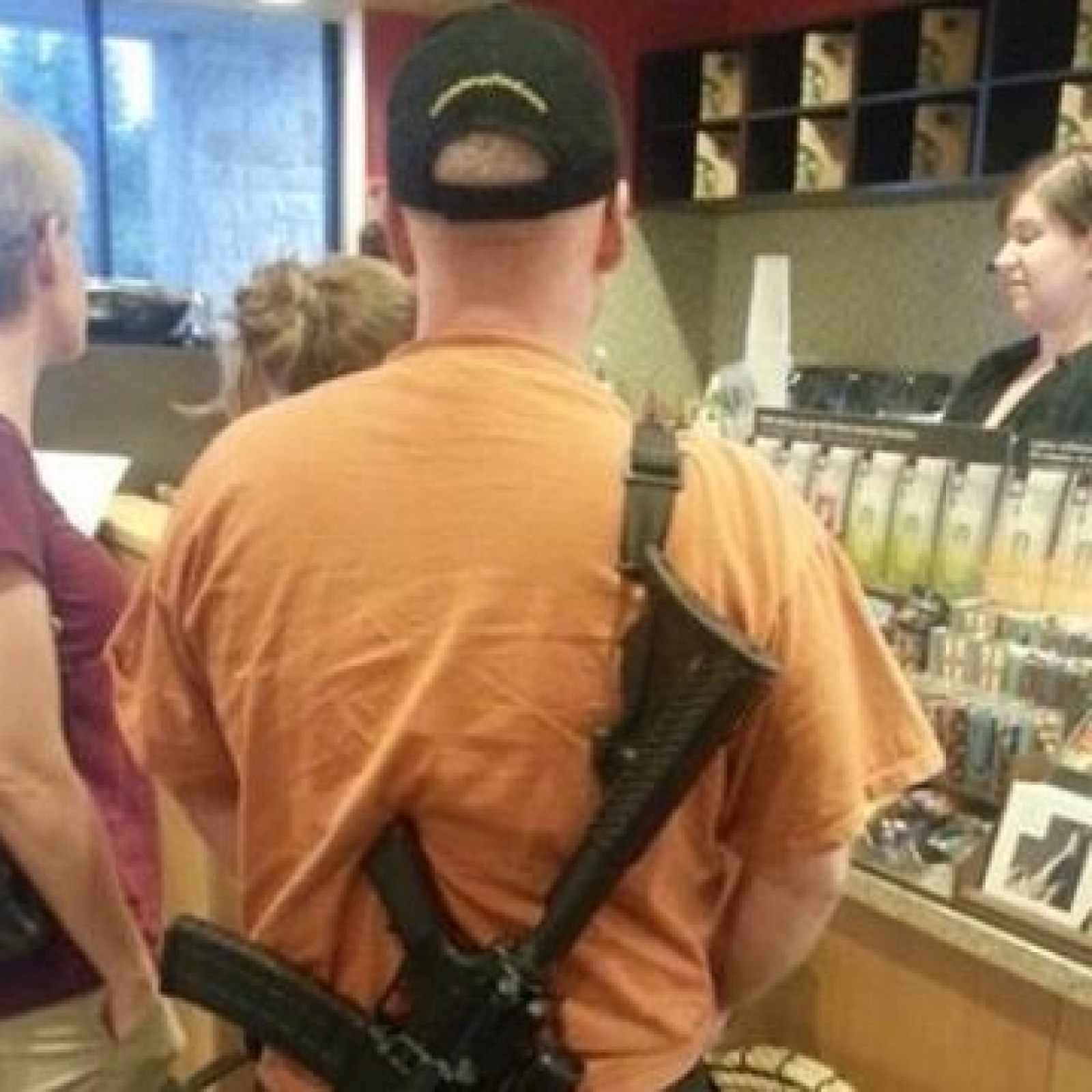 Photo of Man With Semi-Automatic Rifle in Starbucks Line Sparks Debate Over  Public Firearm Safety