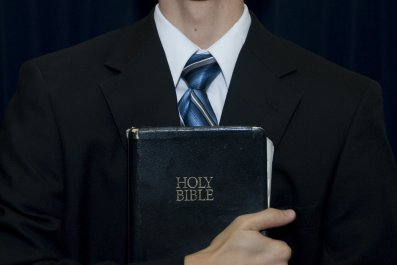 pastor holding bible stock photo
