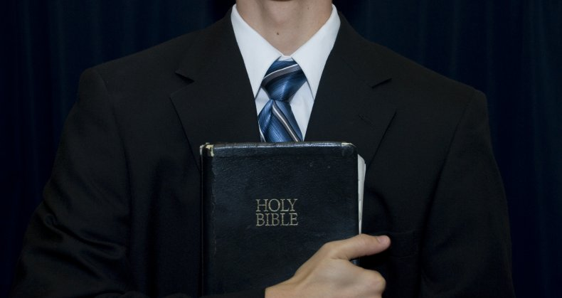 pastor holding bible stock photo