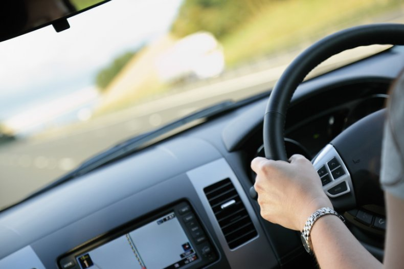 Woman driving vehicle (iStock)