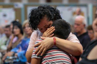 Immigrant mom hugging child