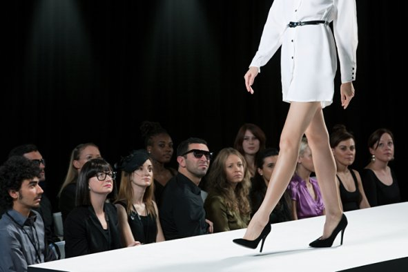 Audience watching model at fashion show