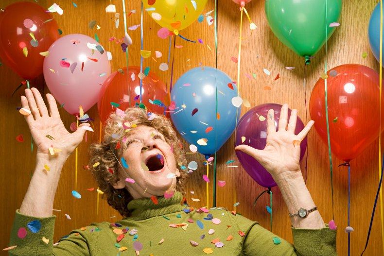 party, birthday, older woman, balloon, confetti, getty,