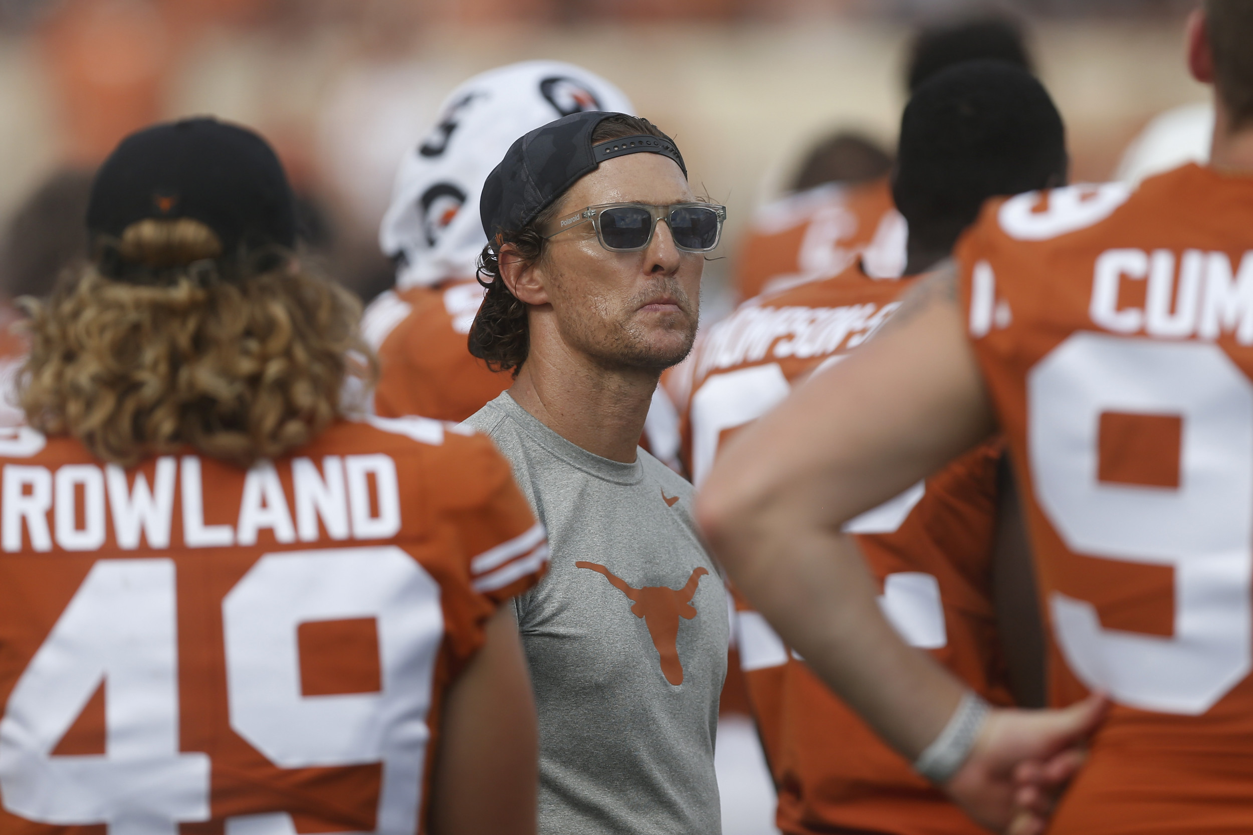 Matthew McConaughey wearing Texas Nike Tee and Cap