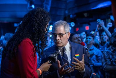 Philadelphia District Attorney Larry Krasner speaks to a reporter at of the election party of public defender Tiffany Caban