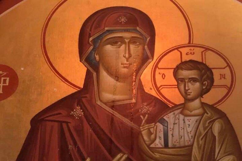 Weeping Virgin Mary painting