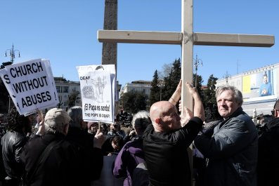 Protesters holding sign and cross