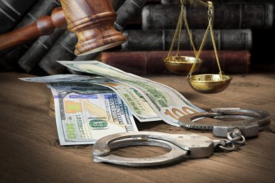 Gavel, cash and scales