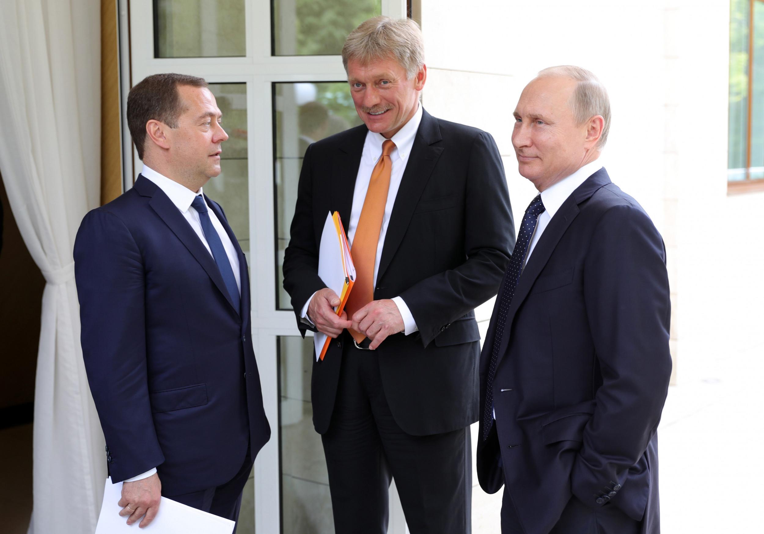President Putin (R) with Dmitry Peskov (C)