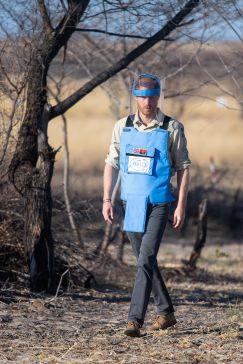 Prince Harry walks through minefield