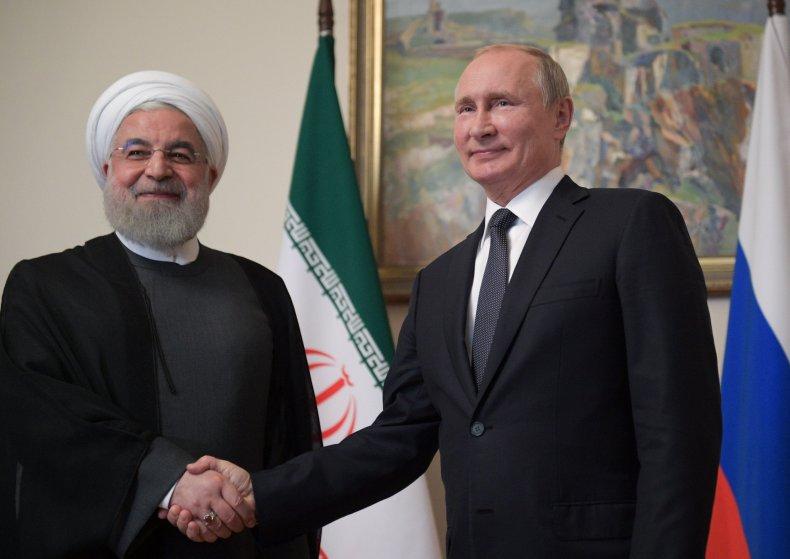 russia putin iran rouhani shaking hands