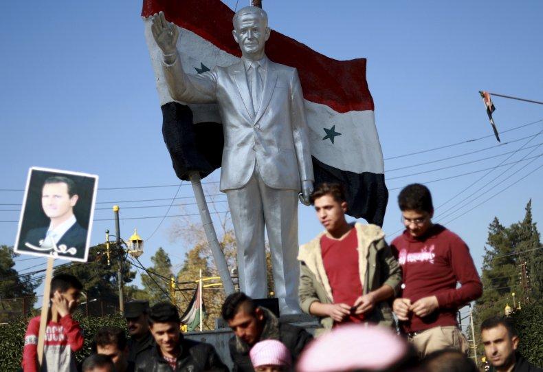 syria kurds assad flag portrait turkey