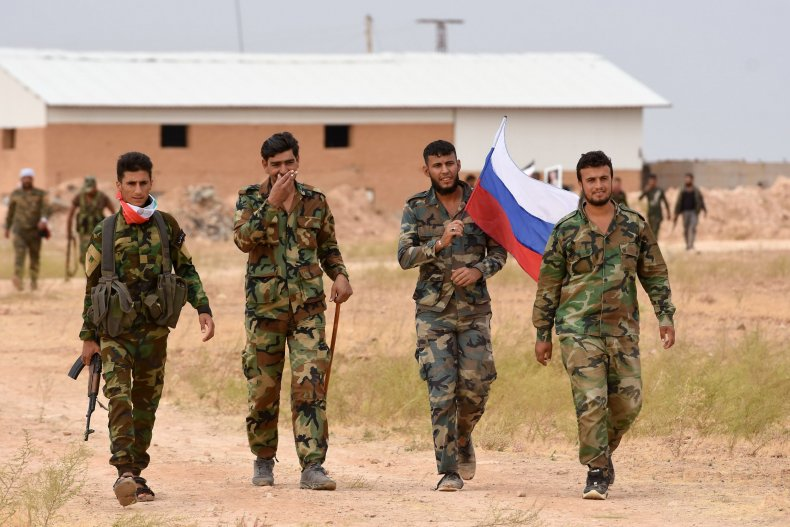 syria military troops russia flag raqqa