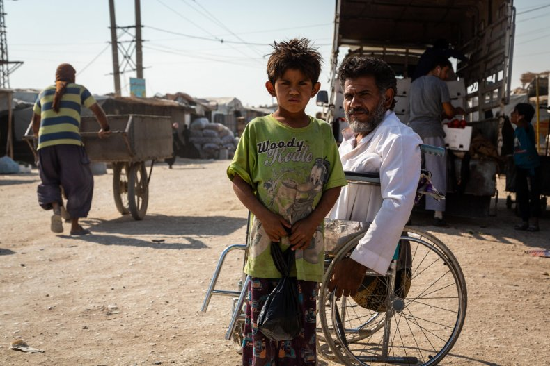 syria war young boy camp