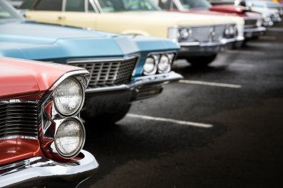 Classic cars lined up at car show