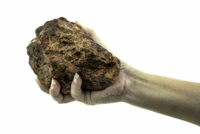 large rock in hand